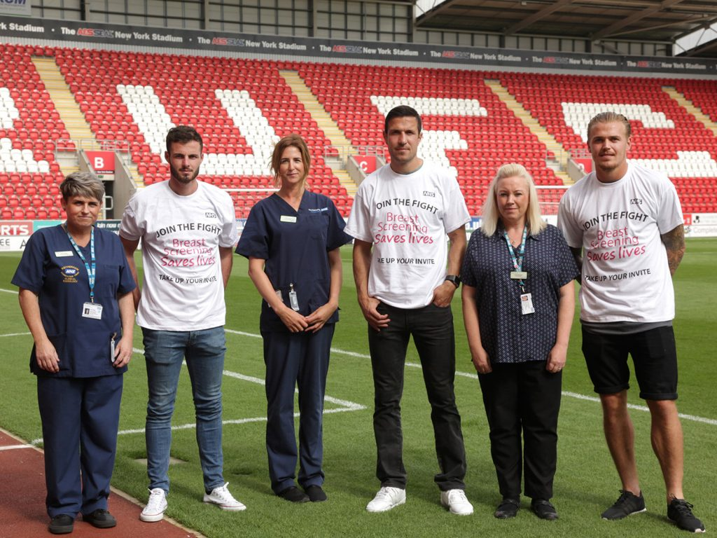 RUFC players with screening team 4x3